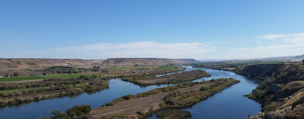 A view of the winding Snake River and the surrounding plain from on top of a bluff