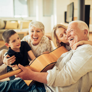 family playing the guitar