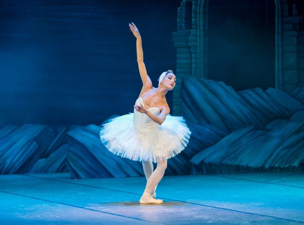 A ballerina dances on stage during a performance
